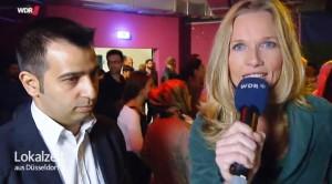 Live im V24 in Düsseldorf. Ein Interview mit dem Vorsitzenden von Terno Drom, Merfin Demir. (Quelle: WDR)